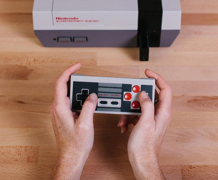 this retro receiver lets you play your nes using a wireless controller