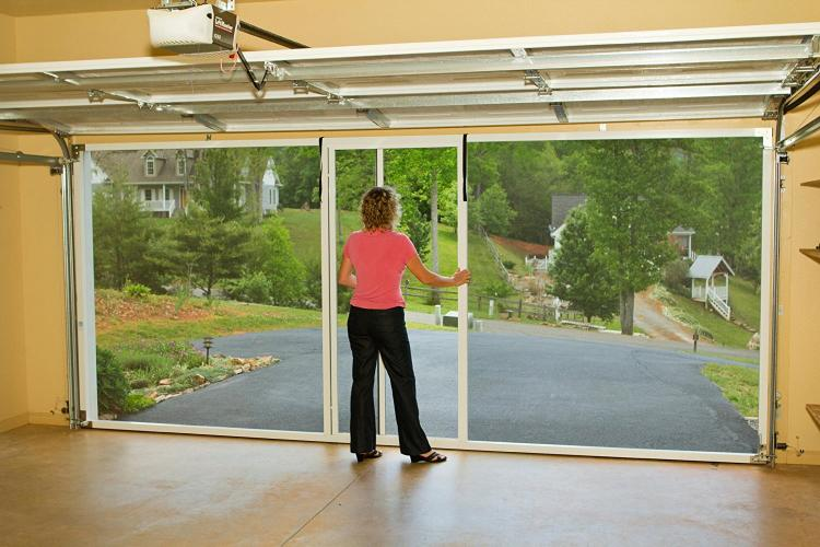 this rolling mosquito screen attaches to your garage door track