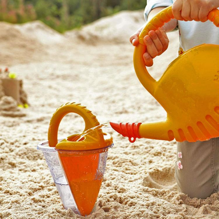 Sand Funnel Mixes Water and Sand