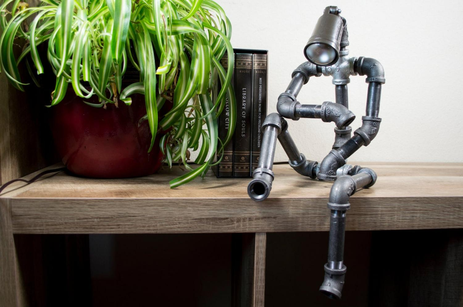 Sitting Pipe Robot Lamp - Industrial design thinking pipe man with lamp for head