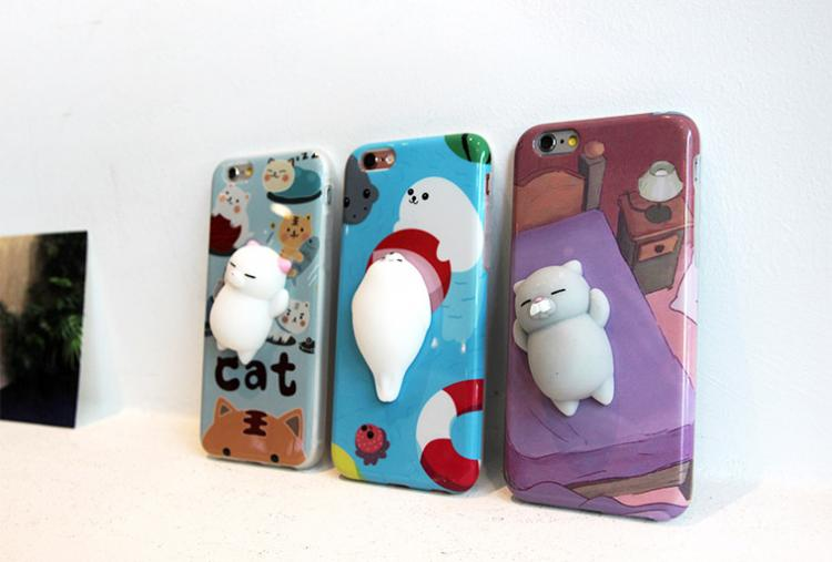 These iPhone Cases Have Soft Squishy Cats On The Back of Them