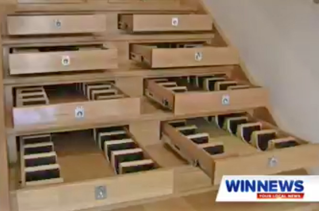 Builder Turned Their Staircase Into an Incredible Wine Cellar - Staircase wine storage drawers system