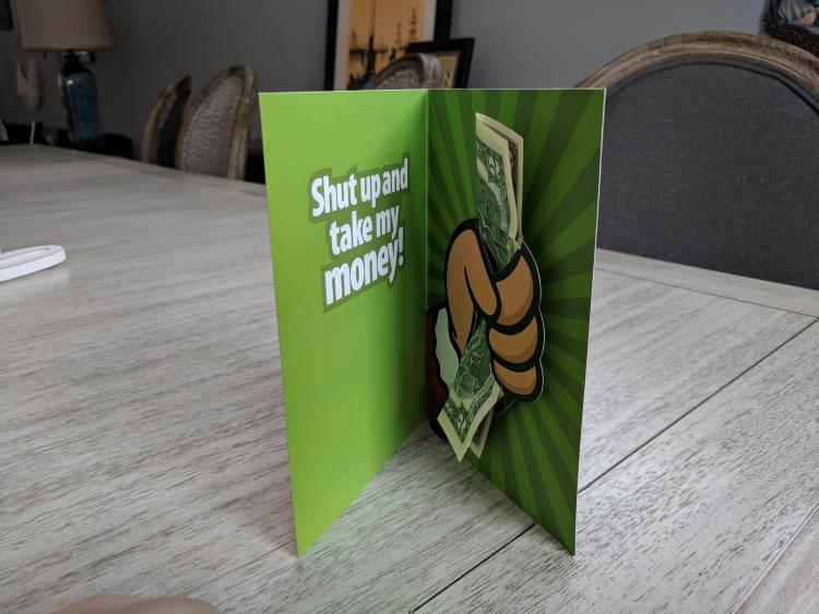 Shut up and take my money Christmas card - Hand giving cash pop-up Christmas card