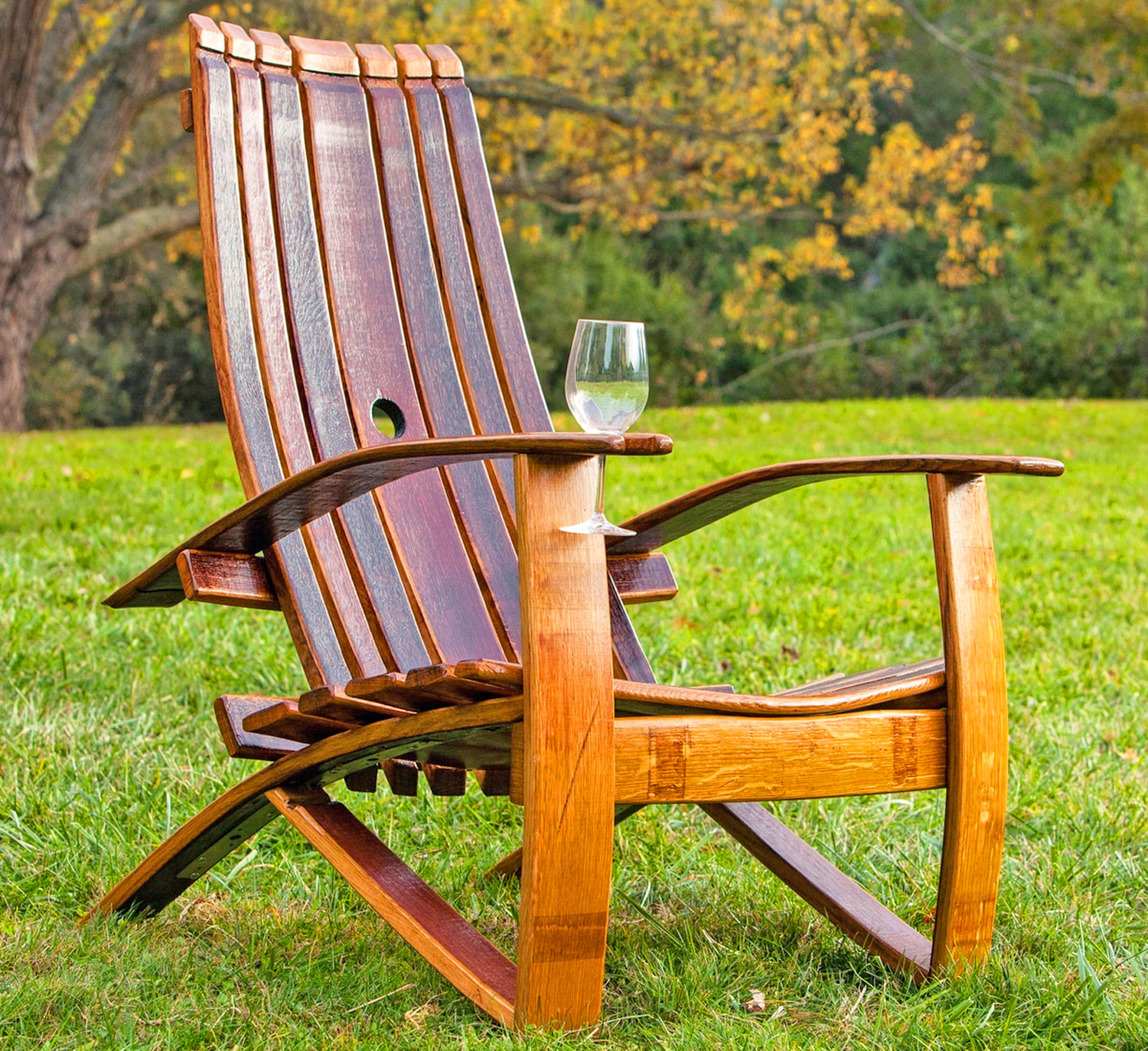 This Adirondack Chair Is Made From an Old Wine Barrel and Has a Slot For a Wine Glass