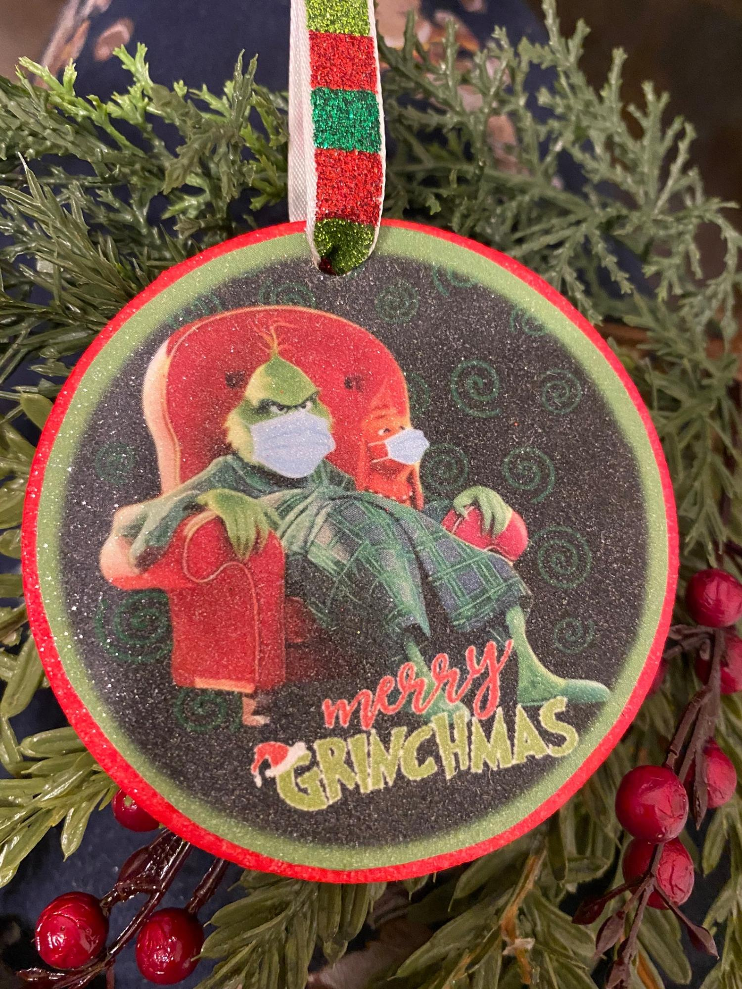 Grinch Sitting In Chair With Facemask Christmas Ornament