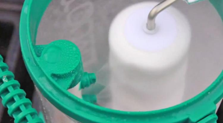 The Rocket Paint Roller Cleaner - Automatic paint roller cleaner attaches to garden hose