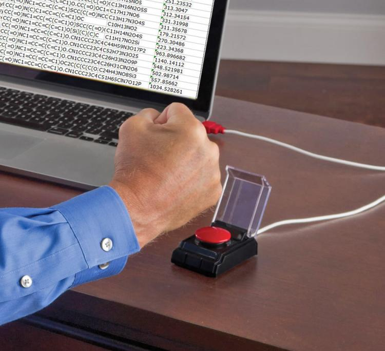 This Big Red Button Attaches To Your Computer To Release