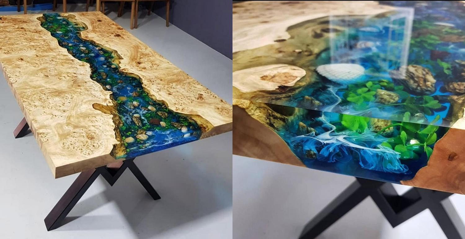 This epoxy table is made to look like a river with real natural life inside of it