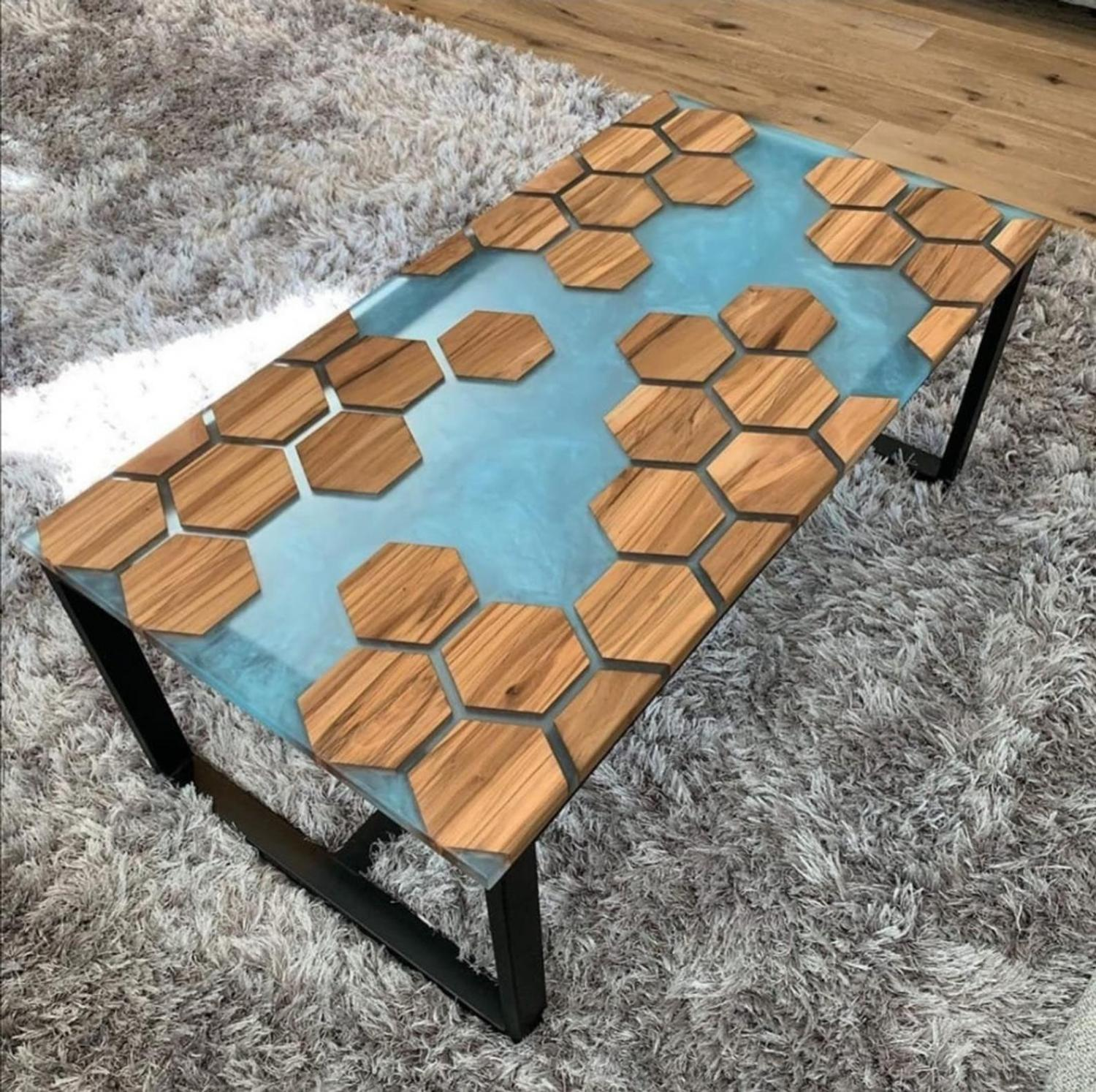 A stunning epoxy table made with wooden polygons with blue resin in-between