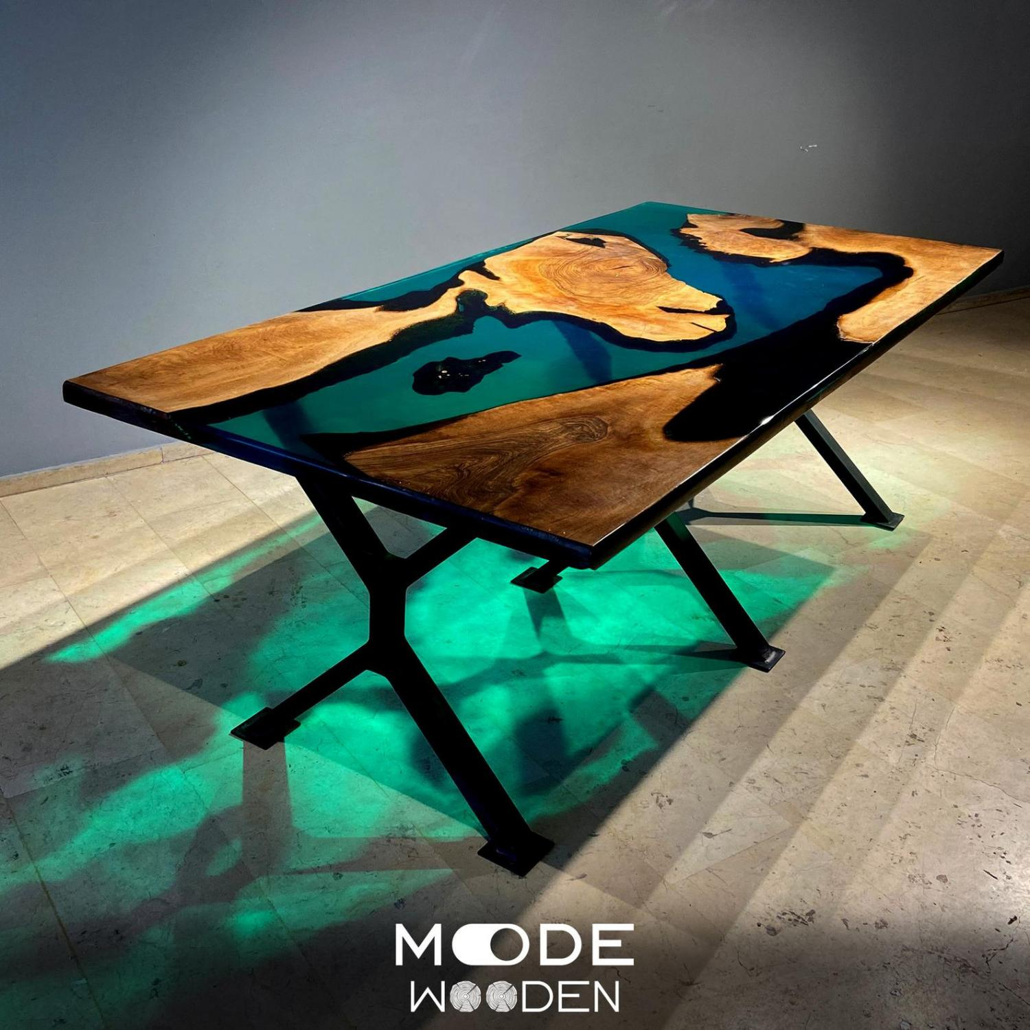 An incredible epoxy/resin table made with walnut wood and resembles islands in a deep blue sea