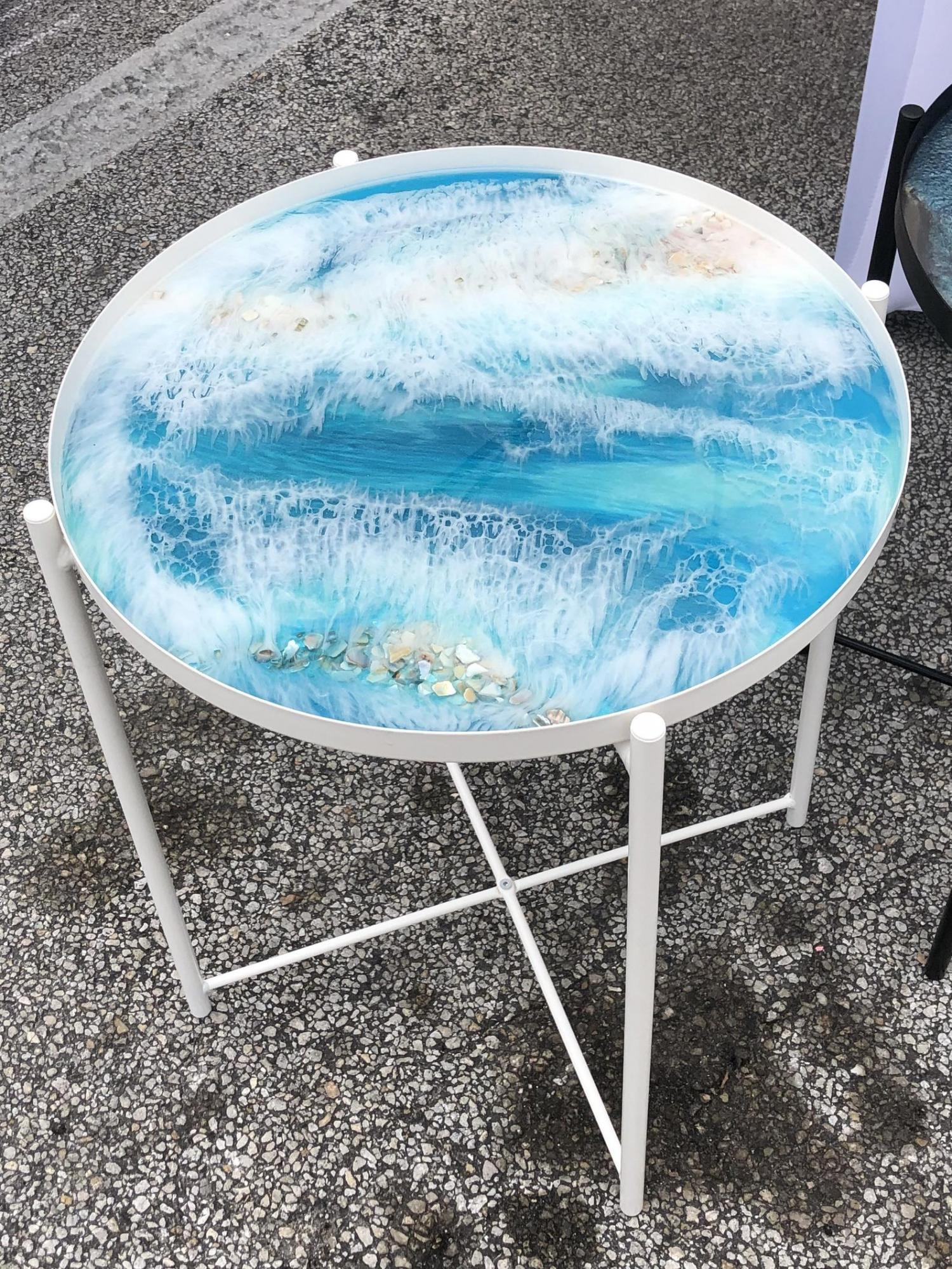 small circular epoxy table is made to look like a piece of art with beautiful ocean waves