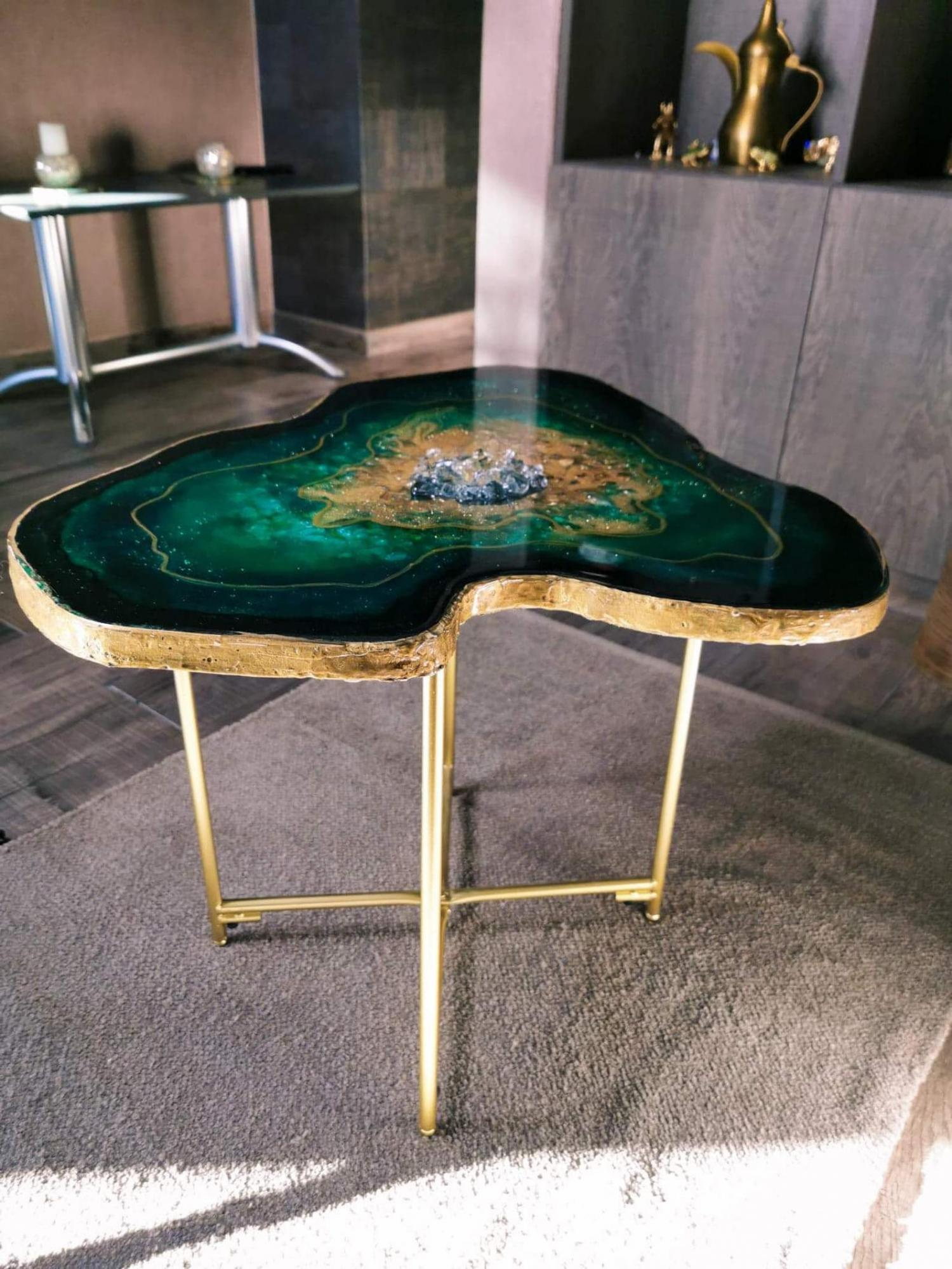 stunning epoxy coffee table is made to resemble a green emerald geode