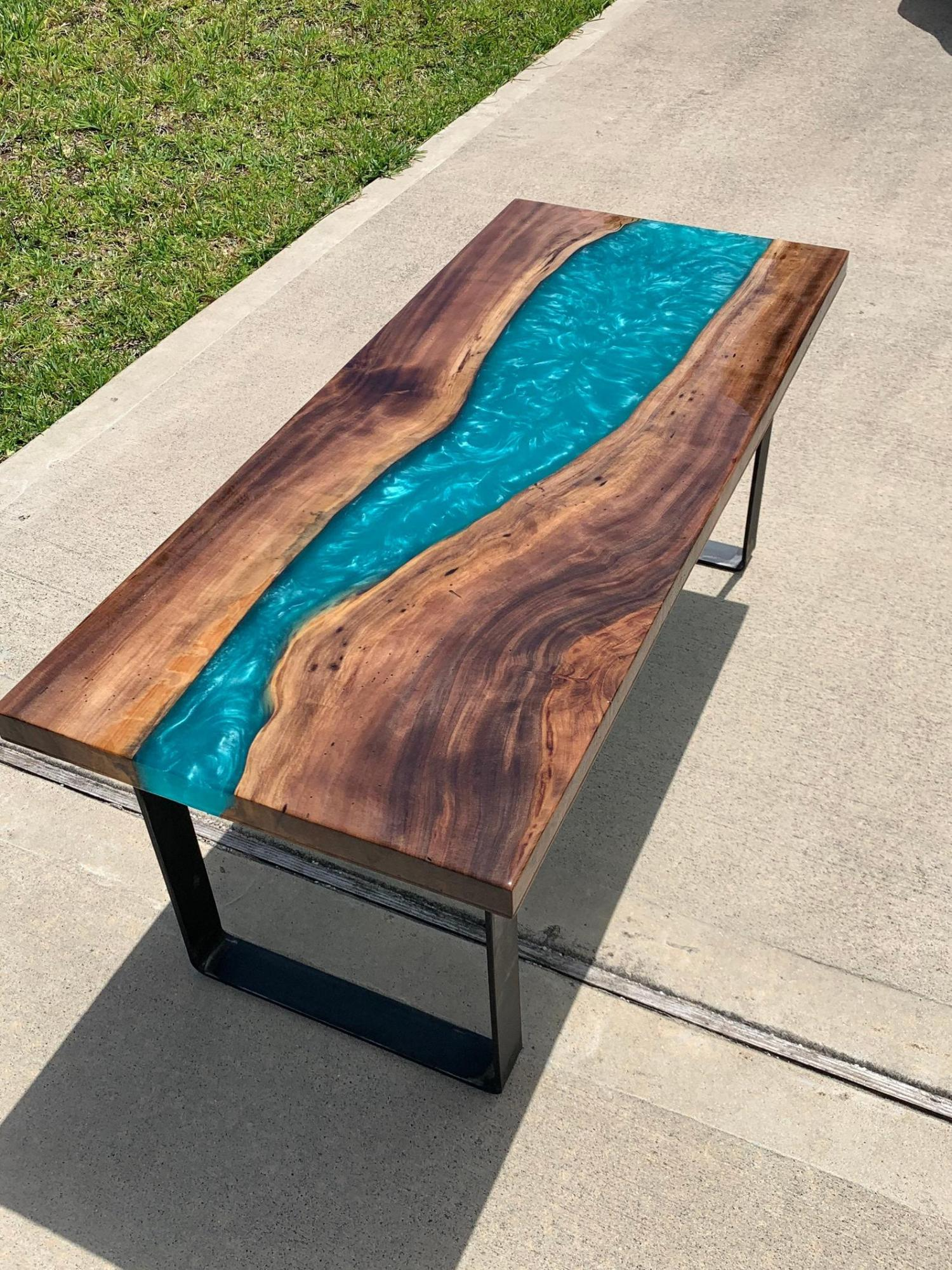 large epoxy table with a beautiful blue river flowing through it