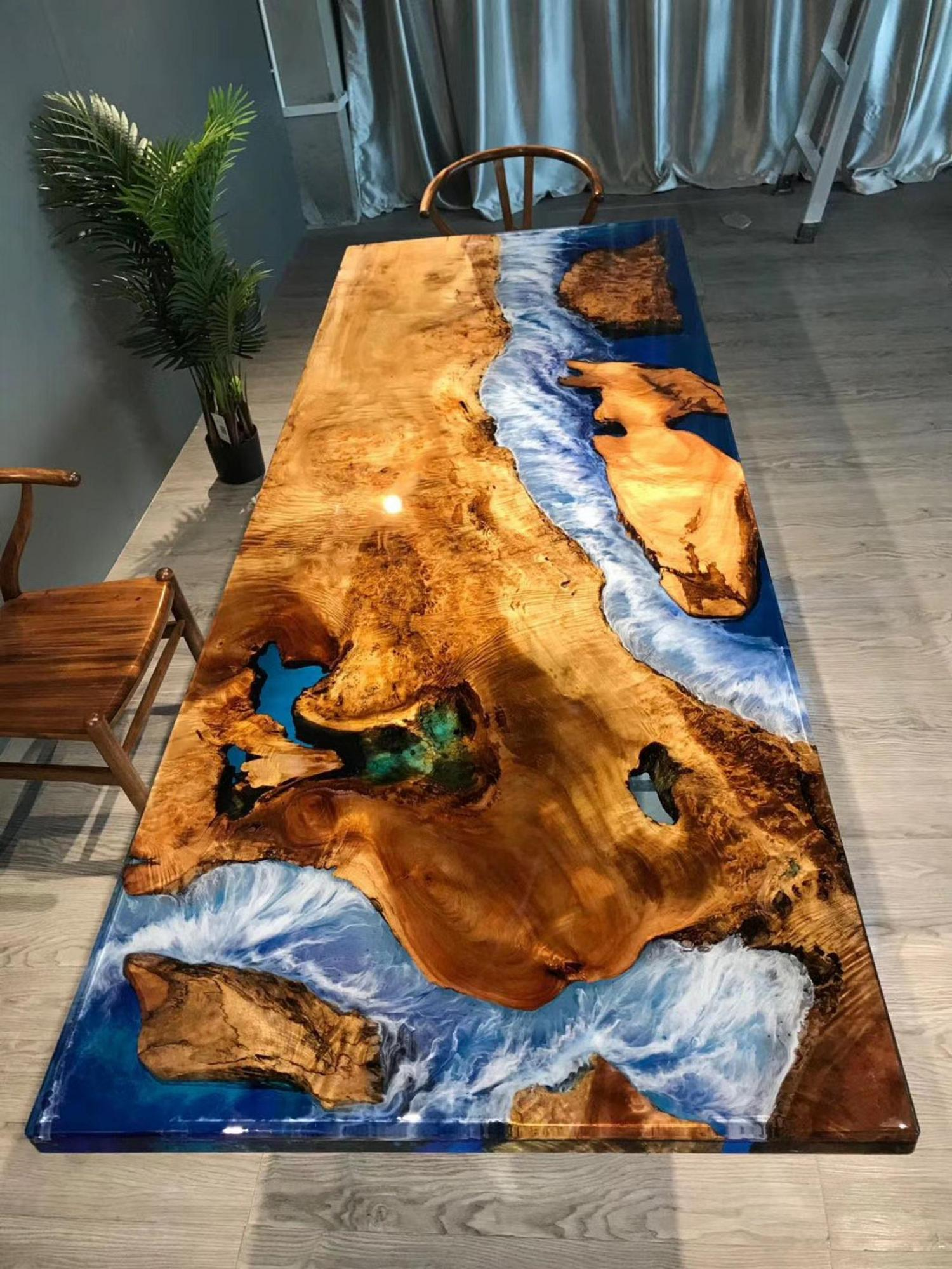 Another beautiful epoxy/resin table with bright blue waters and amazing shorelines with amazing colors