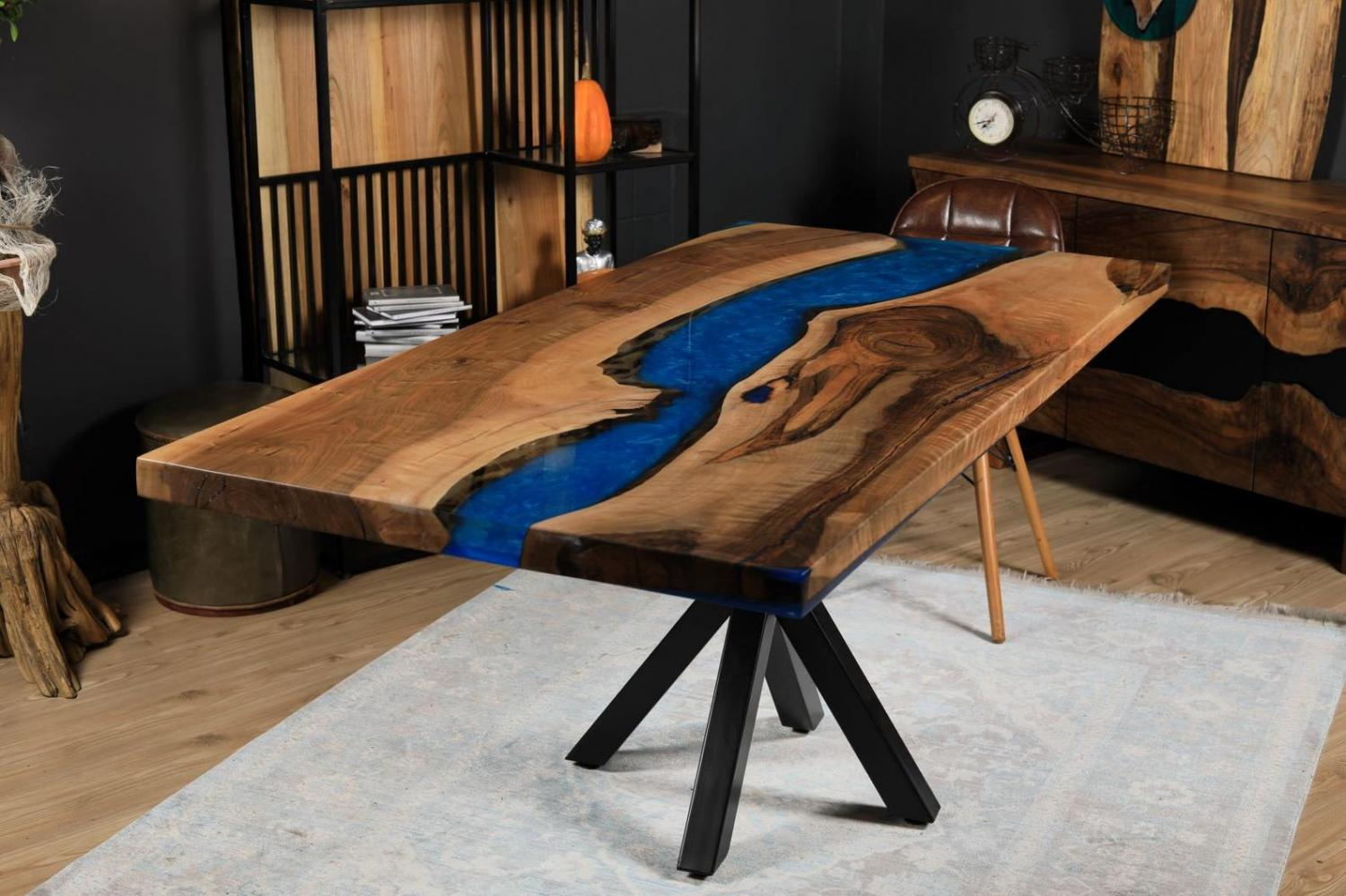 A classy epoxy table with a blue river that's fit for a study or office