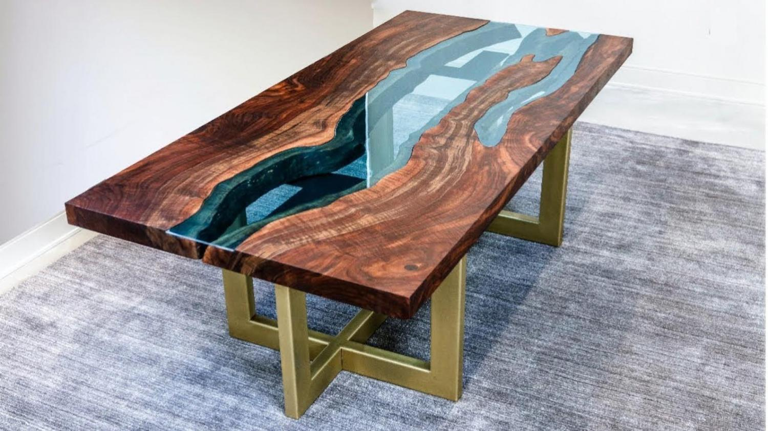 A beautiful epoxy table with a clear river running through it. Makes a perfect dinner table.