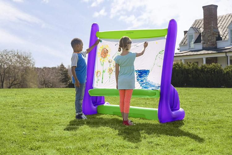 Giant Inflatable Easel Lets Your Kids Paint Outdoors - Outdoor blow-up kids painting canvas