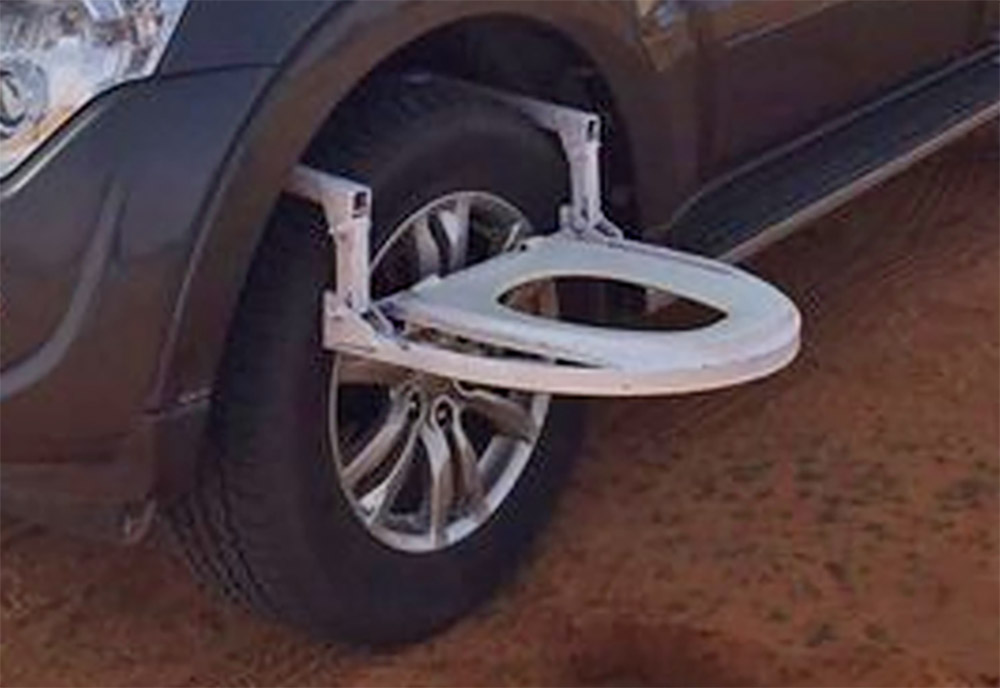 Portable Car Tire Toilet Seat - Toilet attaches to car tire
