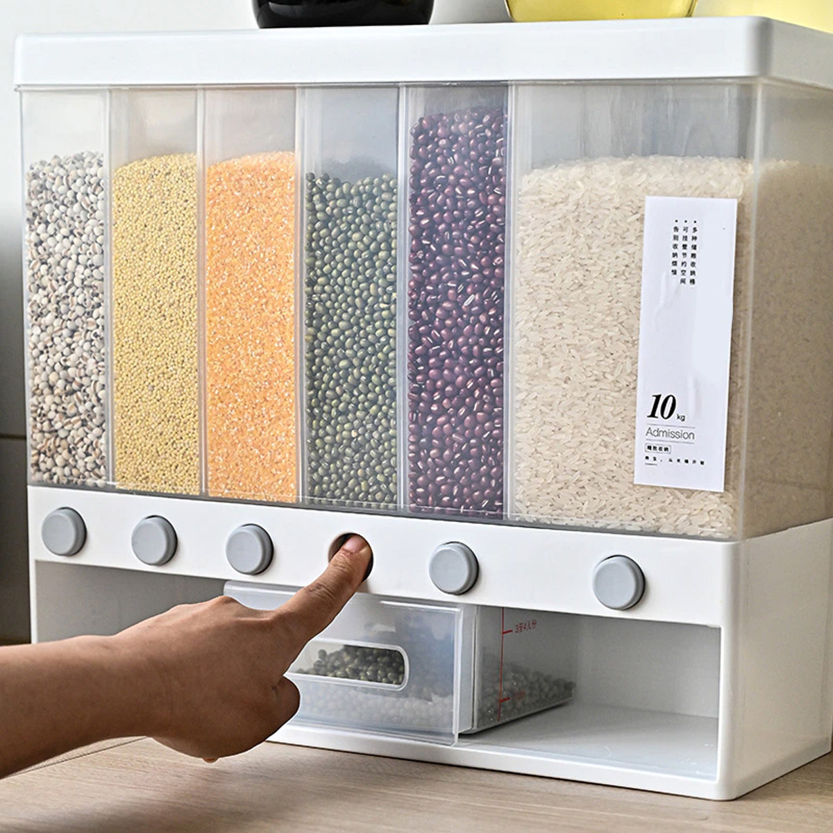 Push button wall mounted food dispenser