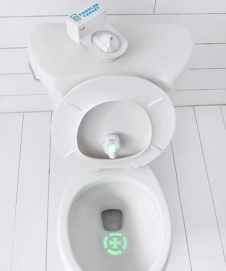 Toddler Target Toilet Light Helps Potty Train - Projected target shape potty trainer