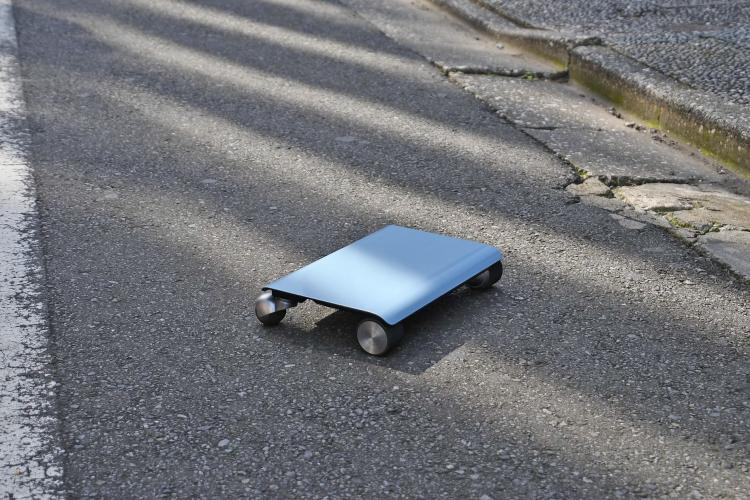 Walk Car: Flat Hoverboard Electric Scooter Looks Like a Laptop - Flat scooter fits into purse