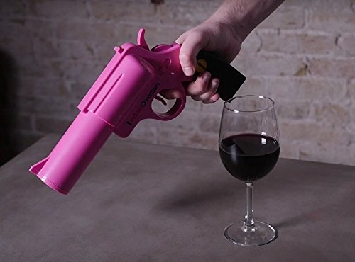 this wine gun opens your bottle of wine with the pull of a trigger. Black Bedroom Furniture Sets. Home Design Ideas