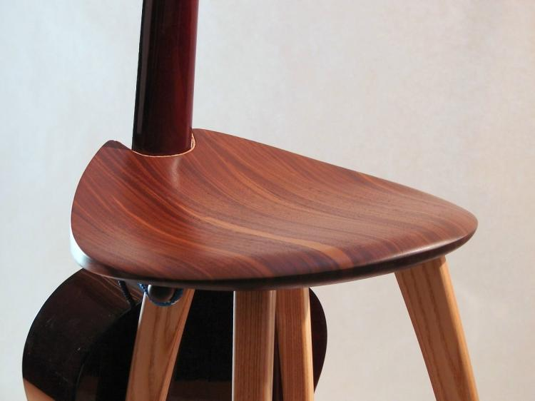 Guitar Stand Designs : This elegant wooden stool has an integrated guitar stand