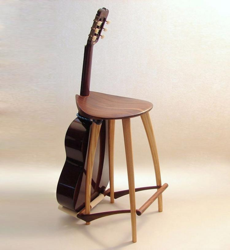 This elegant wooden stool has an integrated guitar stand