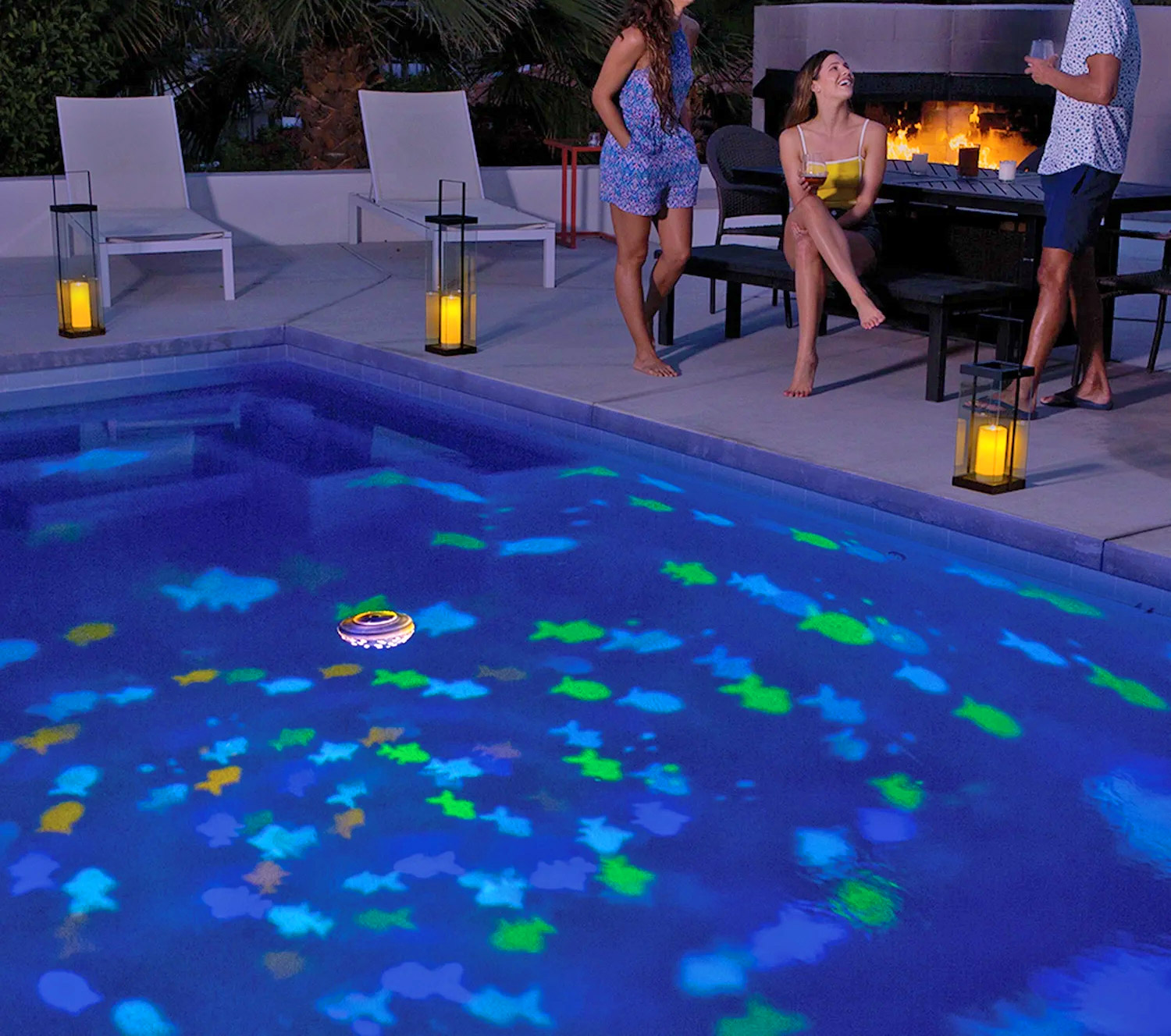 Floating Projection Light Turns Your Pool Into an Aquarium - SwimWays Rainbow Reef Aquarium Pool Light
