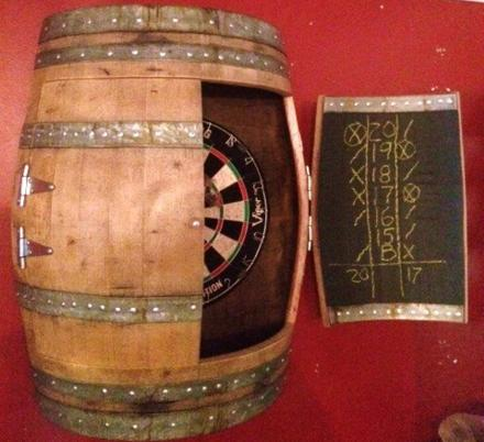 This Wine Barrel Dartboard Cabinet Was Made From a Repurposed Napa Valley Wine Barrel