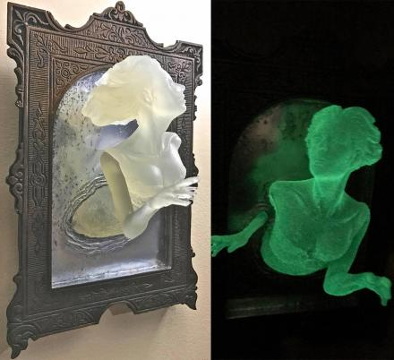 You Can Now Get a Super Creepy Ghost In The Mirror Wall Plaque That Glows In The Dark